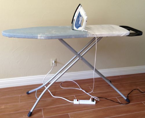 Iron, ironing board and power strip